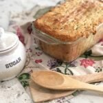 banana bread with wooden spoons and sugar bowl on napkin