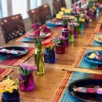 table with brightly colored tableware
