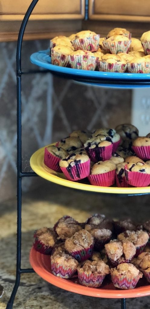 assorted mini muffins on a three tier serving platter