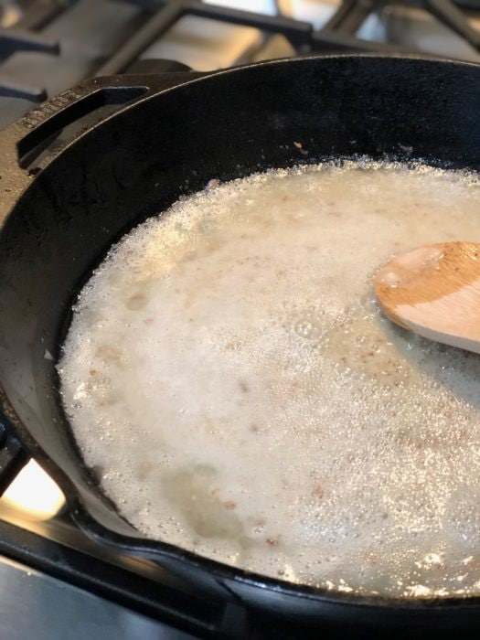 stirring flour and grease in a skillet over the stove