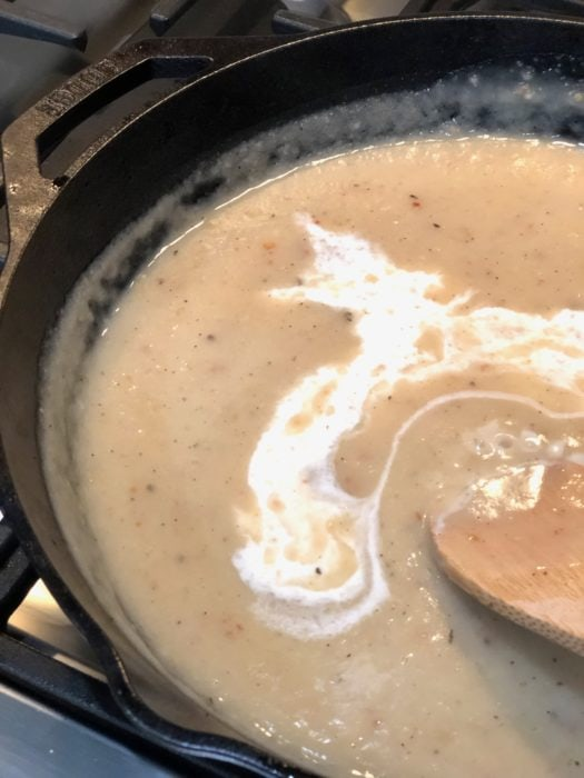 a splash of cream added to the gravy in a cast iron skillet