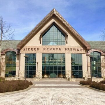 large brewery with windows against a blue sky