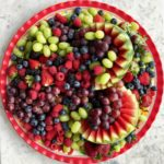 variety of berries and fruit on a platter