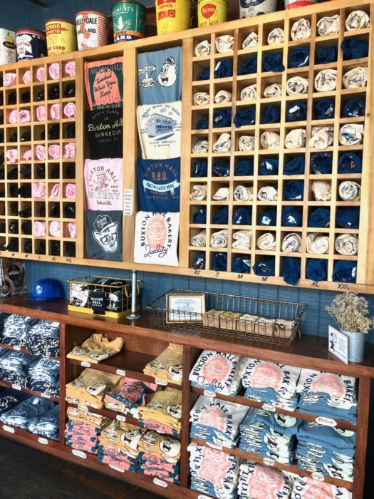Buxton Hall merchandise wall in their BBQ restaurant
