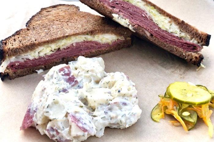 reuben sandwich with potato salad at Rise Above Deli