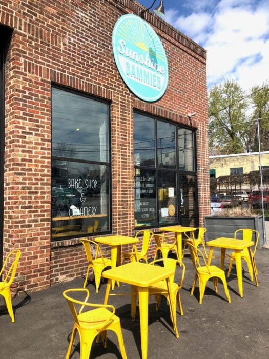 yellow chairs outside the brick restaurant at Sunshine Sammies