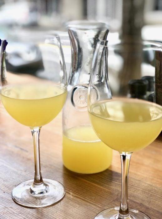orange juice mimosas in window at Chestnut restaurant