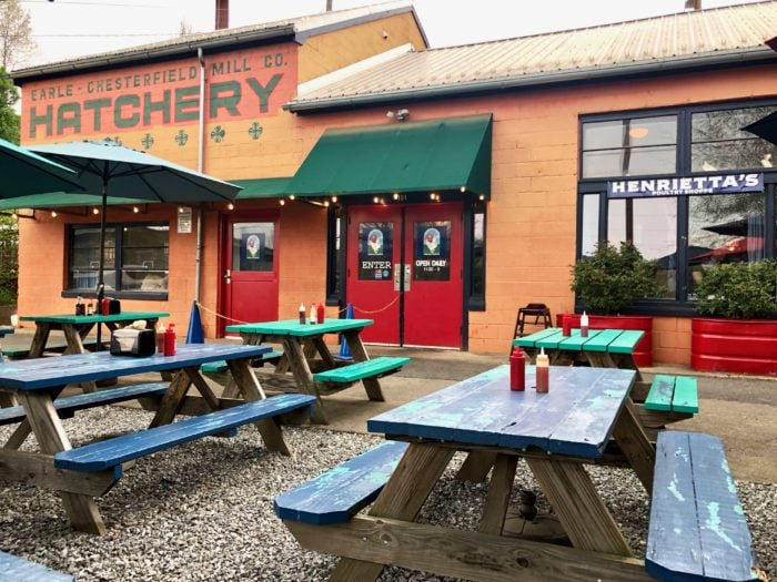 River Arts District restaurant with picnic tables outside