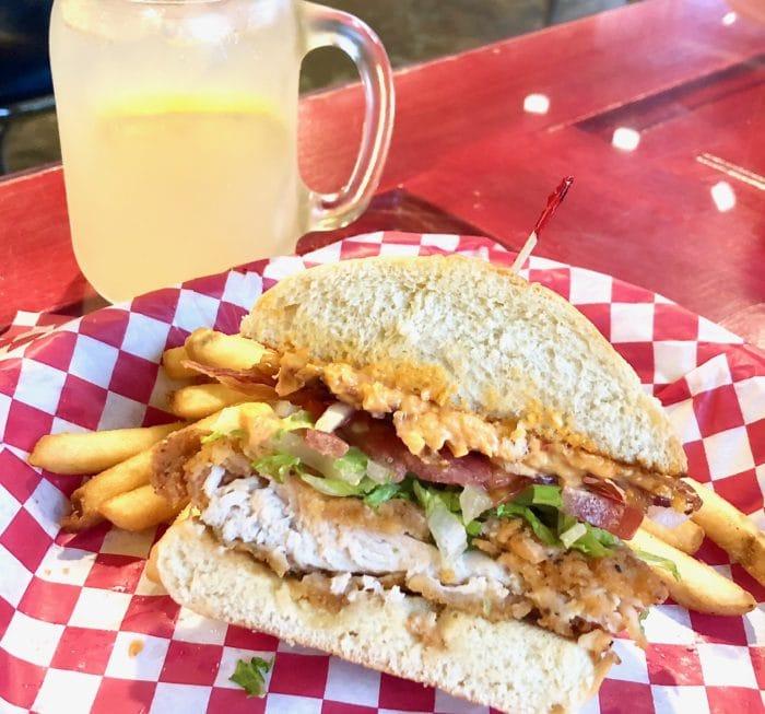 fried chicken sandwich with lemonade
