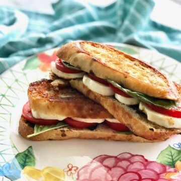 caprese panini sandwiches with mozzarella, basil and tomato