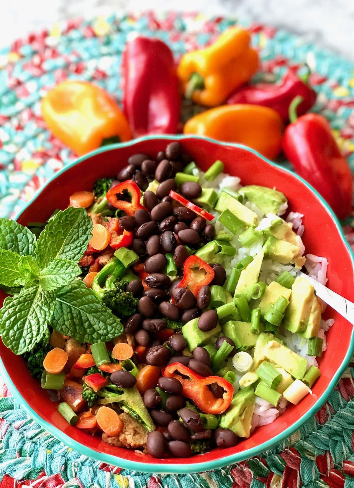bowl of rice smothered with healthy beans and veggies.