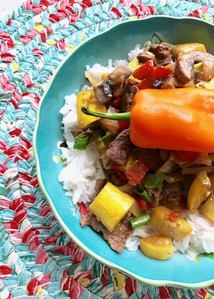 beef and veggies in a rice bowl
