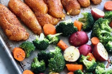 chicken, broccoli, carrots and potatoes on a sheet pan