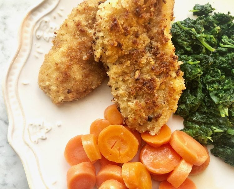 fried chicken tenders with carrot rounds and chopped spinach