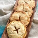 peach hand pies on a wooden tray
