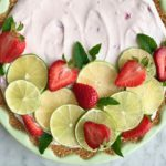 strawberry lime margarita pie in a green pie plate