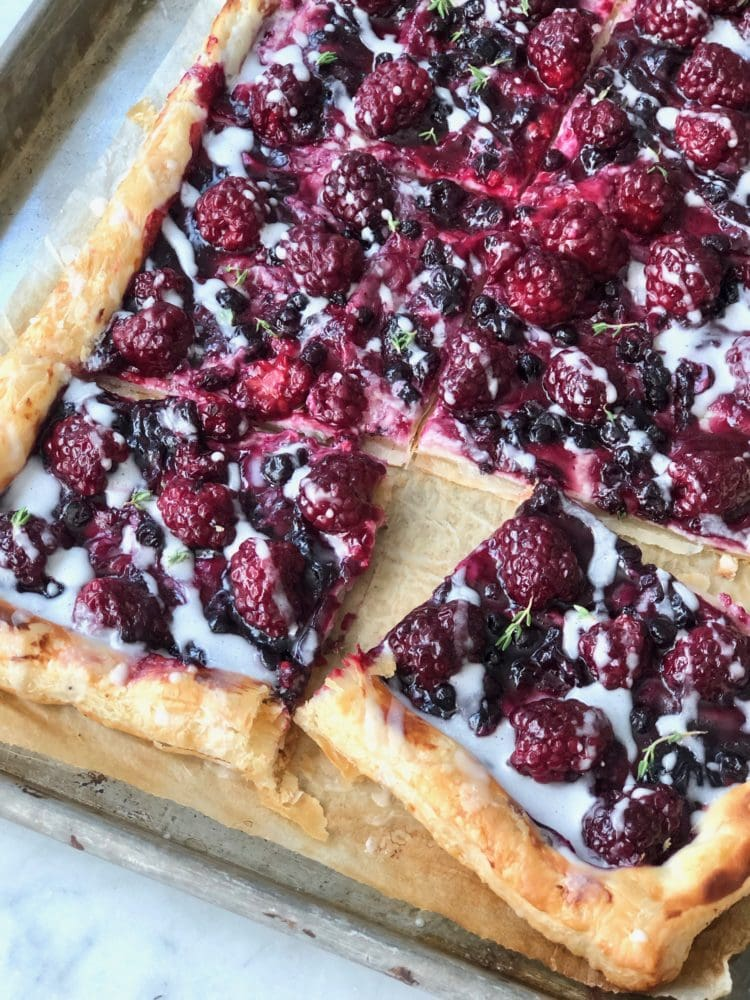 blackberries and cream cheese baked on puff pastry with icing