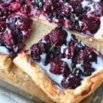 a slice of blackberry cheese danish ready to eat on a sheet pan