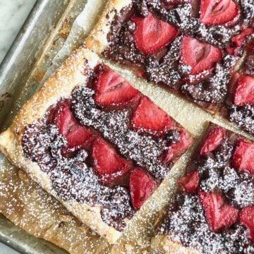 chocolate strawberry tart on a sheet pan