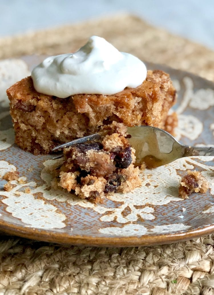 granny tag's prune cake with whipped cream on top