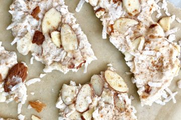 pumpkin spice coconut bark broken into pieces on parchment paper
