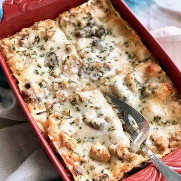 Portobello Chicken Lasagna in orange casserole dish