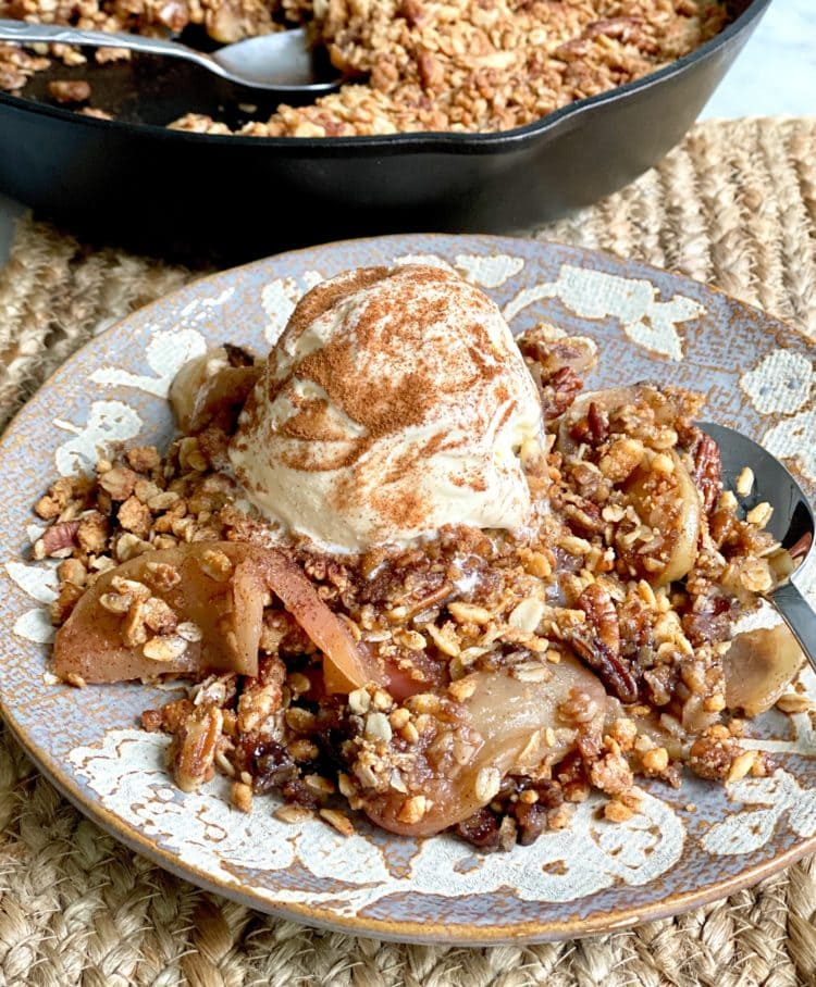fried apple crisp with a scoop of ice cream