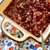 cranberry pecan salad on a floral napkin with pecans, pineapple and cranberries