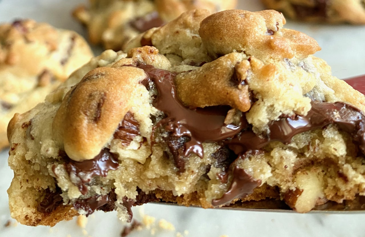 chocolate chip cookie with chocolate dripping down the sides