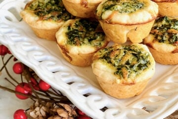 mini quiche tart appetizers on a white plate