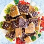 salted chocolate toffee bars on a cake plate