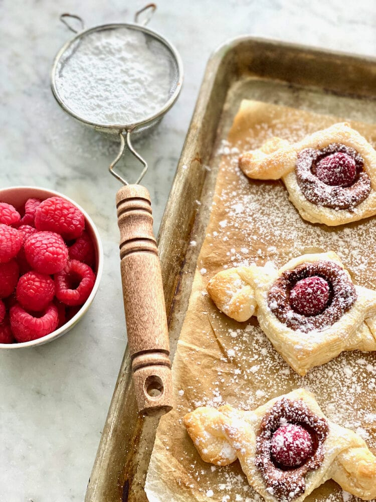 Raspberry Mocha Twists with raspberry, puff pastry and mocha cream on a sheet pan.