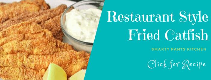 fried catfish with tartar sauce and lemon wedges