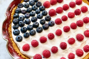 pie in graham cracker crust with American flag decorations on top