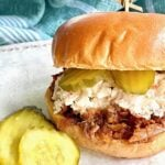 barbecue sandwich with coleslaw and pickles on a bun