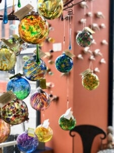 colorful glass balls in window at store