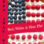 patriotic american flag pie made from blueberries and raspberries saying Happy July 4th