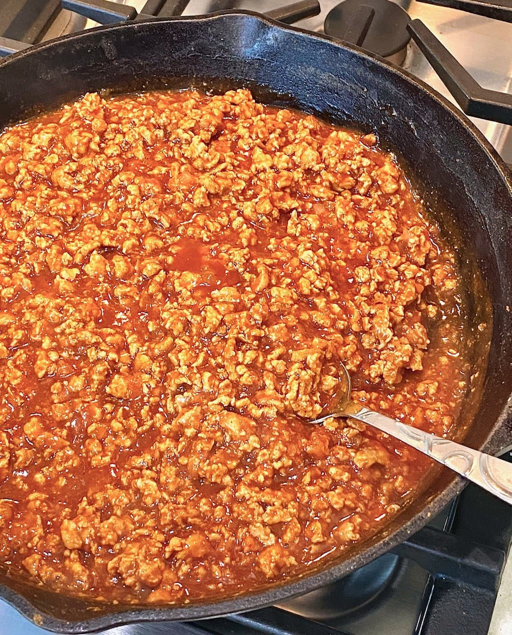 hot dog chili in a cast iron skillet