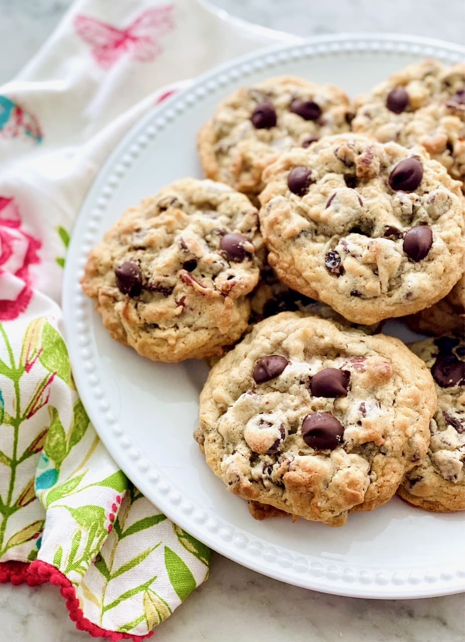 plate of oatmeal chocolate chip cookies on a floral napkin.