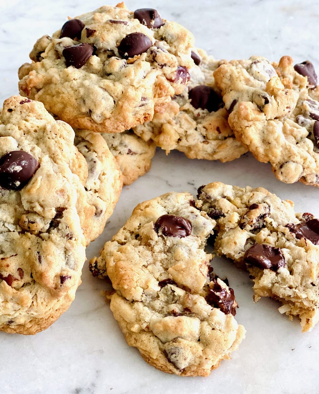 cluster of oatmeal chocolate chip cookies with one broken in half