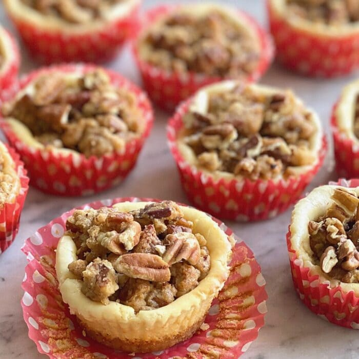 Bailey's Streusel Cheesecake Cups in red polka dot liners