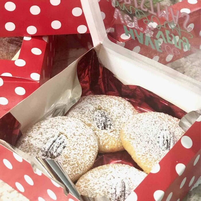 red gift box filled with Aunt Julia's Cheese Biscuits.