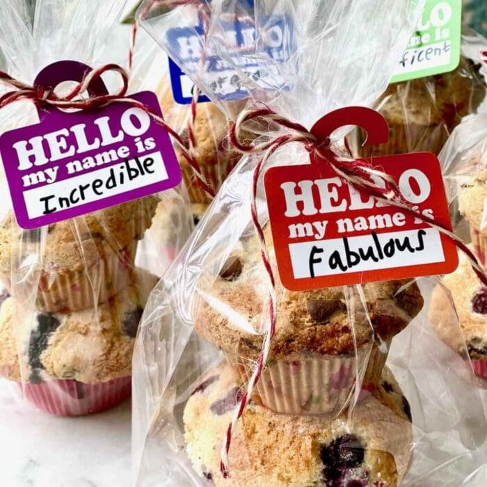 Chocolate Raspberry Muffins wrapped in plastic and tied with name tags.