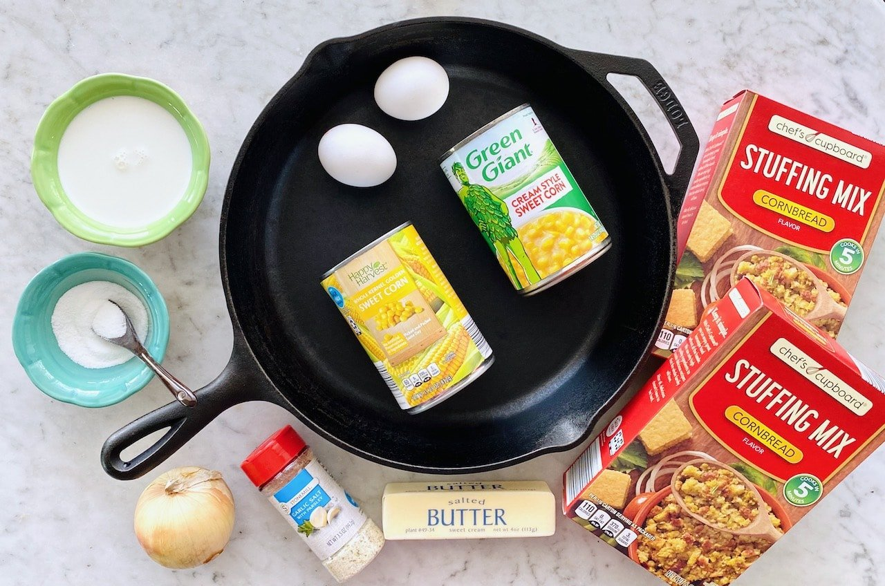 ingredients for sweet corn casserole shown around a cast iron skillet.