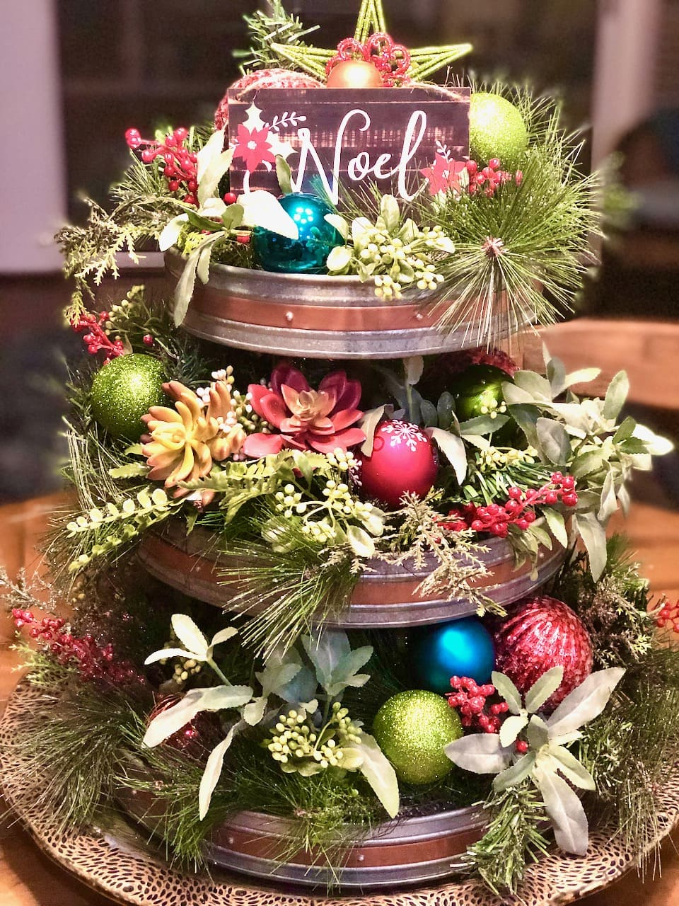galvanized tier decorated with balls and greenery for a southern Christmas.