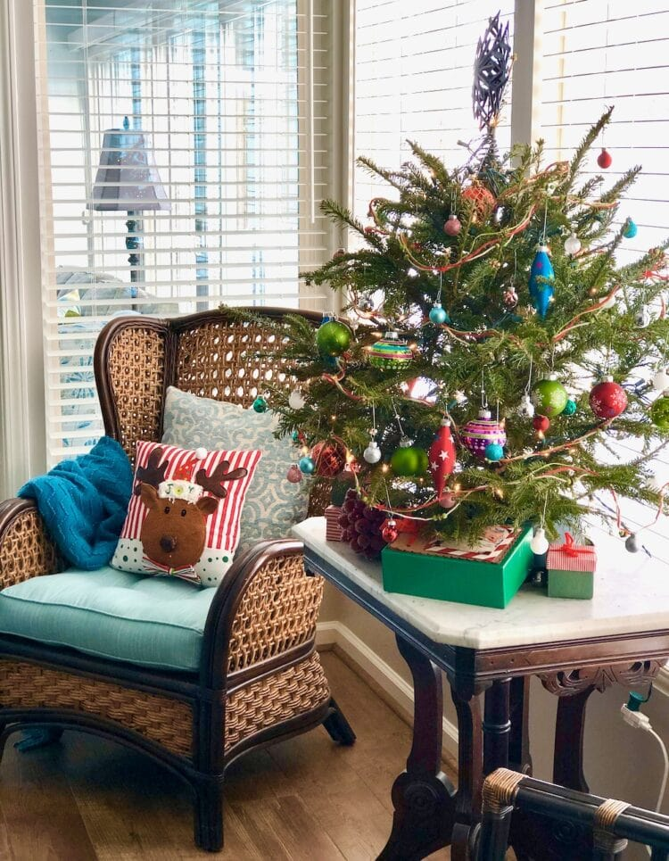 small tree decorated with shiny green and blue ornaments for a southern Christmas.