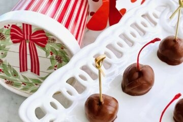 chocolate covered bourbon cherries on a white plate.