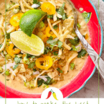 a red bowl of white chicken chili with limes on top