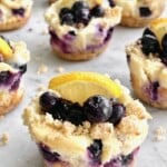 blueberry cheesecake cupcakes with a lemon slice on top.