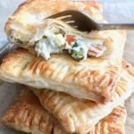 chicken pot hand pies with a fork taking a bite on the top